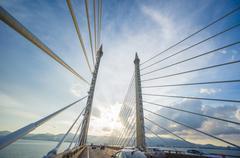 towers of bridge connecting george town on penang island and seberang prai on - stock photo