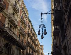 streetlight on a beautiful street of barcelona - stock photo