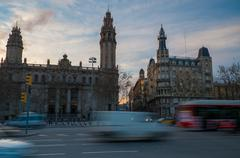Fast moving cars against postal and telegraph building in barcelona Stock Photos