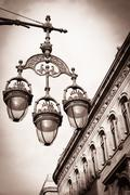 sepia picture of a streetlight on a beautiful street of barcelona - stock photo