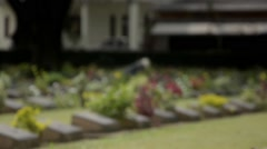 Grave keeper at the Kanchanaburi War Cemetery Stock Footage