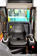 digger driver position - stock photo