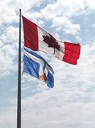 flags of canada and toronto in the wind - stock photo