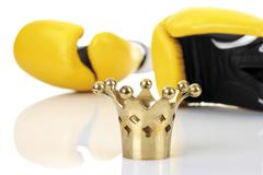 Yellow boxing gloves with a golden crown Kuvituskuvat