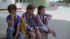 Pupils Sitting in School Yard - stock footage