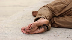 Homeless dirty feet with flies - stock footage