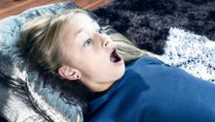 Frightened girl watching scary horror - stock footage