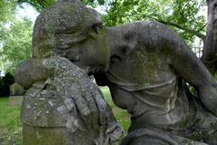grieving woman, sculpture in stone, cemetery of st. mary nikolai parish, pren - stock photo