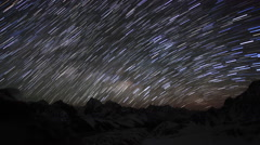Time lapse of stars behind mountains Everest, Lhotse and Makalu from Gokyo Ri Stock Footage