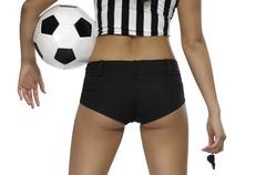 sexy woman in referee outfit with a soccer ball - stock photo