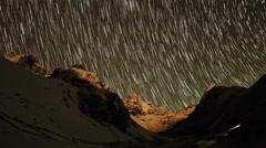 Time lapse of stars behind mountains Kyajo, Pharilapche, Machhermo Glacier Stock Footage