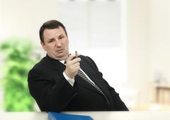 Haughty interviewer confusing applicant Stock Photos
