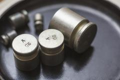 Close-up of weights on scale in laboratory Stock Photos