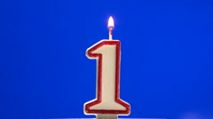 Number 1 - one birthday candle burning - blow out at the end Stock Footage