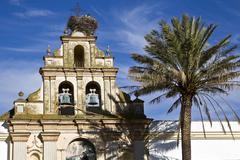 old bell tower in the andalusian village of arcos, spain, europe - stock photo