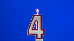 Number 4 - four birthday candle burning - blow out at the end - stock footage