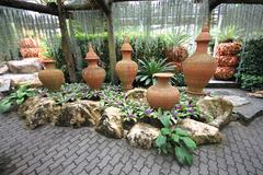 A composition of pots with flower-beds in the Nong Nooch tropical garden Stock Photos