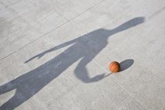 Shadow playing basketball Stock Photos
