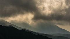 Fagarash Serbota ridges sunbeams dark clouds 4K Stock Footage