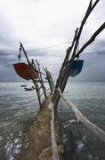 Suspended boats in a storm at cape savudrija, adriatic sea, istria, croatia,  Stock Photos