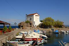 Stock Photo of greek orthodox christianity, small fishing boats in the harbor of skala sikam