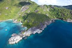 Stock Photo of the coast of anse major, with the typical granite rocks of the seychelles, ma