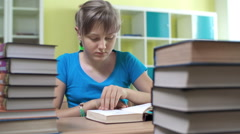 Girl Skimming Textbooks - stock footage