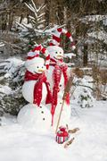 snowman couple in love - christmas outdoor decoration with snow - stock photo