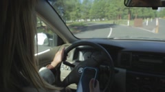 Young Woman Texting While Driving Stock Footage
