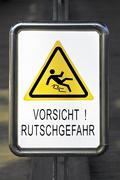 Sign, warning, vorsicht rutschgefahr, caution slippery Kuvituskuvat