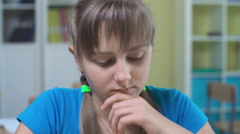 Schoolgirl Pondering in Classroom Stock Footage