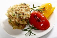 potato roestis with roasted capsicum and rosemary - stock photo