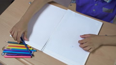 Boy Drawing in Notebook Stock Footage