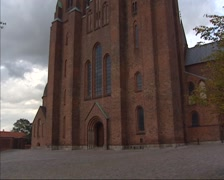 Roskilde Cathedral - tilt up two towers flanking the west front entrance Stock Footage