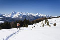 cross-country skier during the ascent to cima bocche mountain above passo val - stock photo