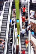 Shopping abstract. people rush on escalator motion blurred Stock Photos