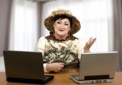 Stock Photo of online help desk woman in halloween costume