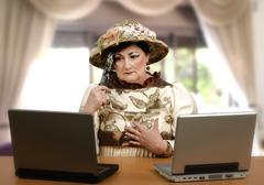 Stock Photo of woman in old clothes reading the online news