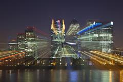 Canary wharf financial district viewed over the river thames with a zoom burs Stock Photos