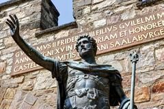 Stock Photo of bronze statue of the roman emperor augustus at the entrance of the reconstruc