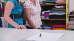 Choosing textile for dress on costumer - stock footage