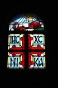 Stained glass window with a cross, Orthodoxy - stock photo