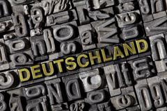 "the word ""deutschland"", german for ""germany"", made of old lead type - stock photo"