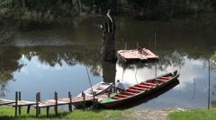 Brazilian Amazon man sitting on a canoe in a jungle stream  Stock Footage
