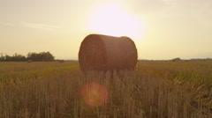 SLOW MOTION: Bales of hay at sunset - stock footage