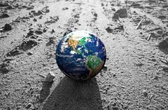 the earth globe on rocky mars like surface. concepts of earth protection, env - stock photo