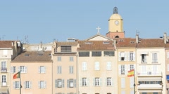 The bell tower and traditional house in Saint-Tropez harbour - stock footage