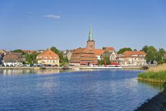 view of neustadt, lake neustaedter binnenwasser, the church and pagodenspeich - stock photo