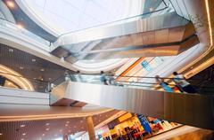 modern shopping mall. the escalators - stock photo