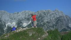 AERIAL: Man teaching his girlfriend names of the mountains - stock footage